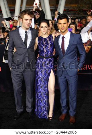 Taylor Lautner, Robert Pattinson and Kristen Stewart at the Los Angeles premiere of 'The Twilight Saga: Breaking Dawn Part 1' held at the Nokia Theatre L.A. Live in Los Angeles on November 14, 2011. - stock photo