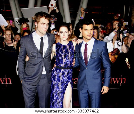 Taylor Lautner, Robert Pattinson and Kristen Stewart at the Los Angeles premiere of 'The Twilight Saga: Breaking Dawn Part 1' held at the Nokia Theatre in Los Angeles, USA on November 14, 2011. - stock photo