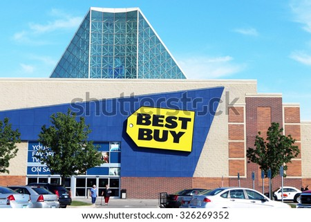 TAYLOR, MI-OCTOBER, 2015: Customers leaving a Best Buy store in this Detroit suburb. Note the glass roof which allows natural light into the store. - stock photo