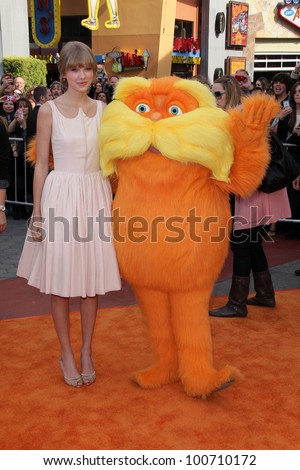 """Taylor Swift and Lorax at the """"Dr. Seuss' The Lorax"""" Premiere, Universal Studios, Universal City, CA 02-19-12 - stock photo"""