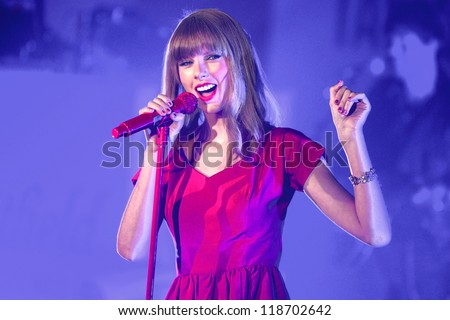 Taylor Swift performs and turns on the Christmas Lights at Westfield Shepherd's Bush, London. 06/11/2012 Picture by: Steve Vas - stock photo