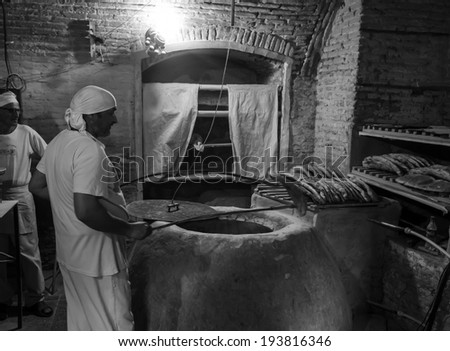 TBILISI, GEORGIA - April 29,  2014: Bakery with traditional wood-burning stove in the street Abo Tbileli, 1, Tbilisi - stock photo
