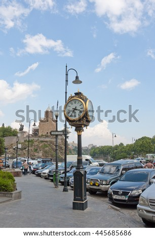 TBILISI, GEORGIA - AUGUST 08, 2013: Street clock in the historical part of Tbilisi - stock photo