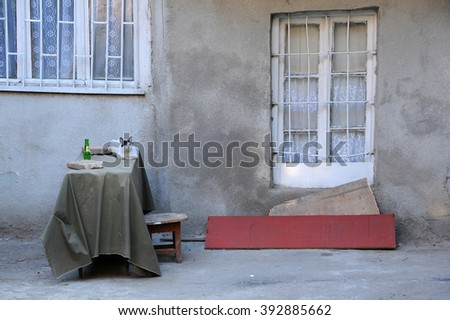 TBILISI, GEORGIA - JUNE 13, 2015: Cat on the table in the courtyard in the historical center of the city - stock photo