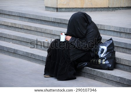 TBILISI, GEORGIA - JUNE 12, 2015: Old Georgian woman begs in the street of the ci - stock photo