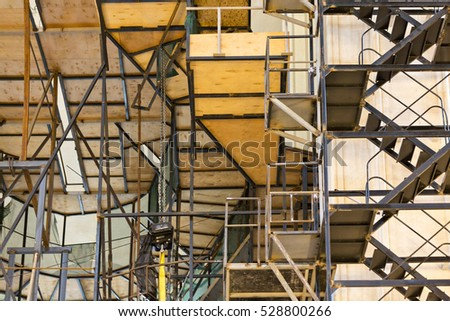 TBILISI, GEORGIA - OCTOBER 25, 2016: Scaffolding and staircase in the Sameba Cathedral, during its restoration, in Tbilisi, Georgia.