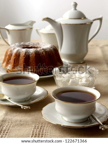 Tea and a cake - stock photo