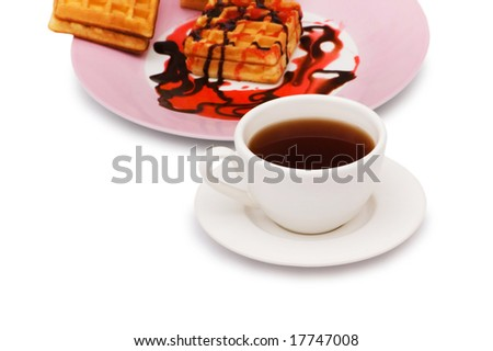 Tea and belgian waffles isolated on the white