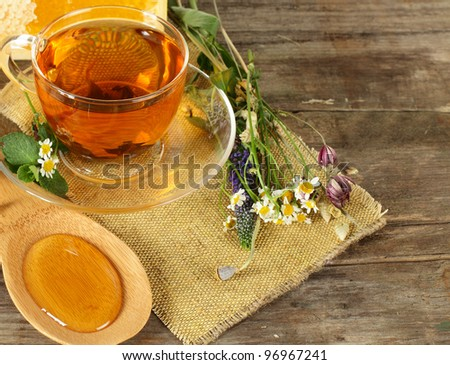 Tea and honey on background - organic food concept - stock photo