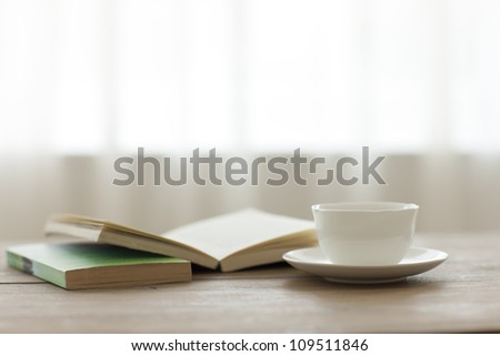 Tea and the book which there is on a table - stock photo