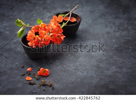 Tea Asian concept. Cast iron cups green tea and flowers. - stock photo