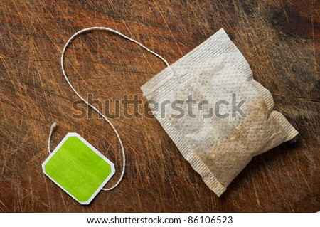 Tea bag on wooden table. - stock photo