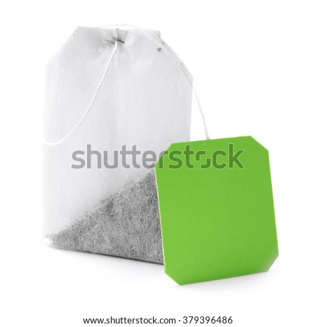 Tea bag with green label, isolated on white