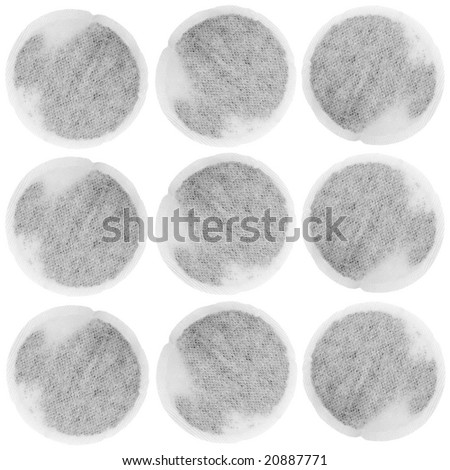 Tea bags in three rows on a horizontal axis, over white background. - stock photo