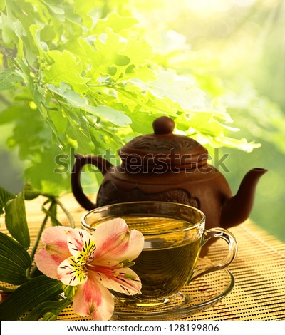 tea ceremony. Green tea, flower and teapot - stock photo