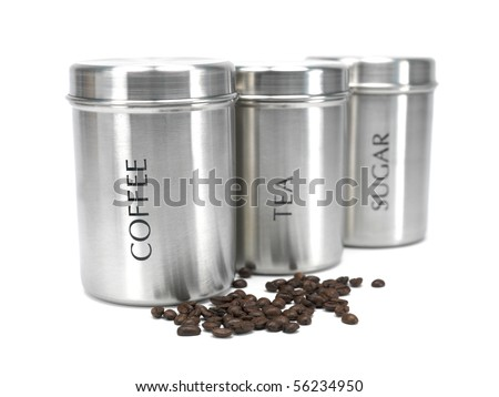 Tea coffee and sugar cannisters isolated against a white background - stock photo