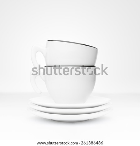 Tea cup and saucers on a white background - stock photo
