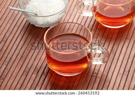 Tea Cup and Sugar in wooden background - stock photo