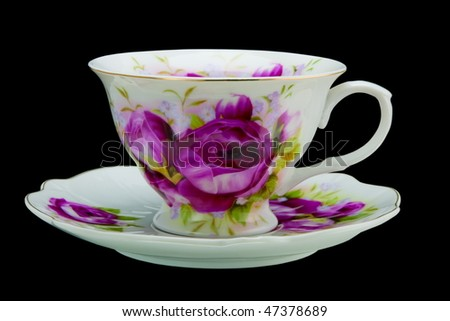 Tea cup isolated on black - stock photo