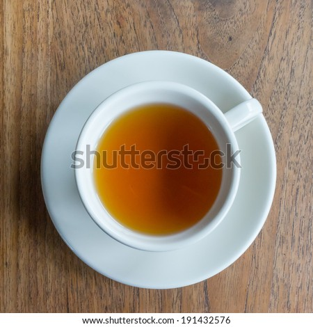 Tea cup on a wood table - stock photo