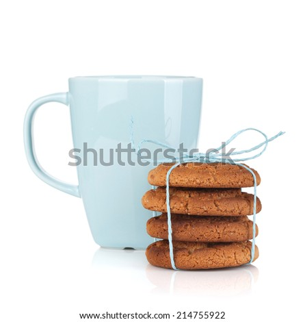Tea cup with homemade cookies. Isolated on white background - stock photo