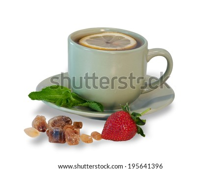 Tea cup with lemon, mint, cane sugar strowberry isolated  - stock photo