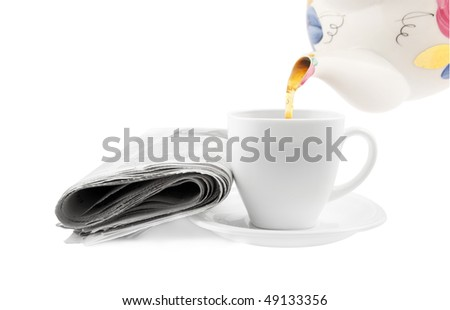 Tea cup with newspaper isolated on white