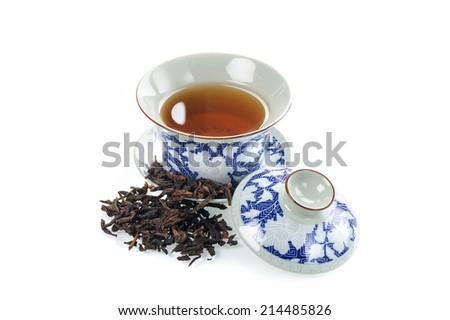 tea cup with tea leaf isolated on white background  - stock photo