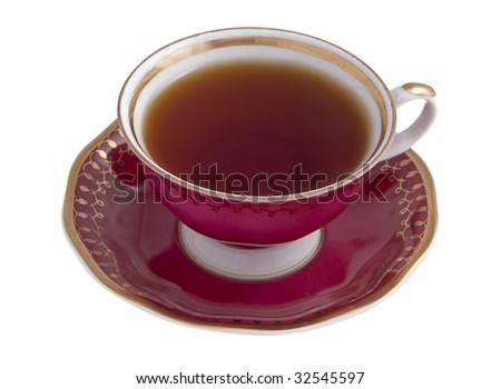 Tea cup with tea on a saucer on a white background - stock photo