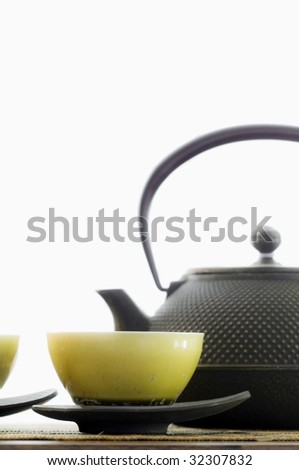 tea cups and tea pot - stock photo