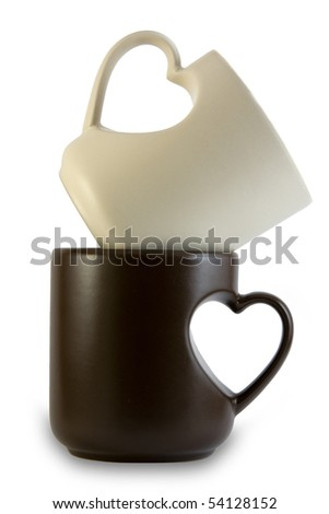 tea cups with heart shape handles one inside another - stock photo