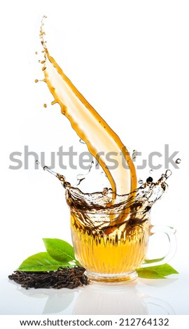Tea flowing in cup - stock photo