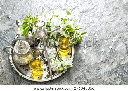 Tea glasses and pot. Oriental silver tableware with decorations. Top view - stock photo