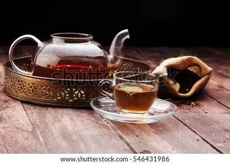 Tea. Herbal tea. Mint leaf. Tea in a glass cup, mint leaves, dried tea, sliced lime. herbs on a slate plate in a restaurant or teahouse