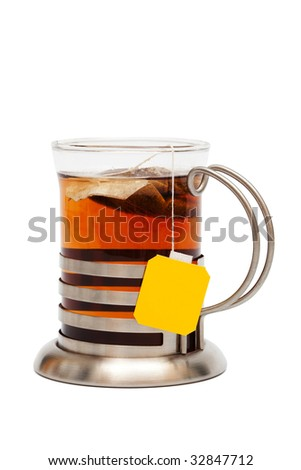 Tea in a glass with a cup holder on a white background