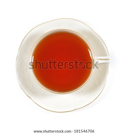 Tea in antique porcelain cup isolated on white background. Porcelain cup and saucer with delicate relief structures and gold decoration. - stock photo
