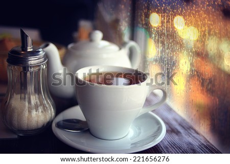 tea in the cafe showcase city - stock photo