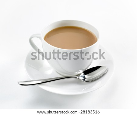 Tea in white cup and saucer with spoon on white background - stock photo