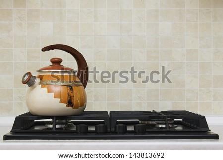 Tea kettle on gas stove - stock photo