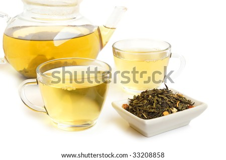 Tea leaves with two cups of tea on white background