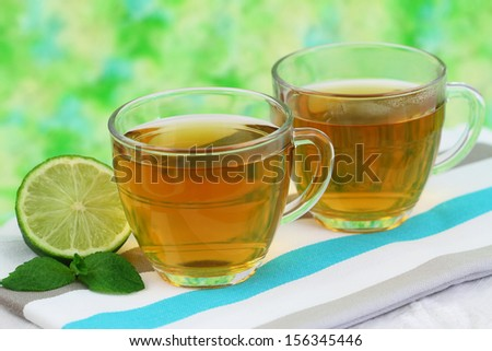 Tea, lime and mint leaves