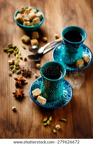 Tea or Hot Wine with Various Spices in Traditional Turkish Glasses on Wooden Background. Selective Focus.