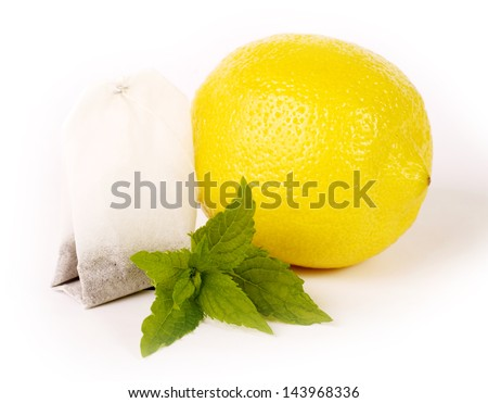 Tea package with lemon and mint - stock photo
