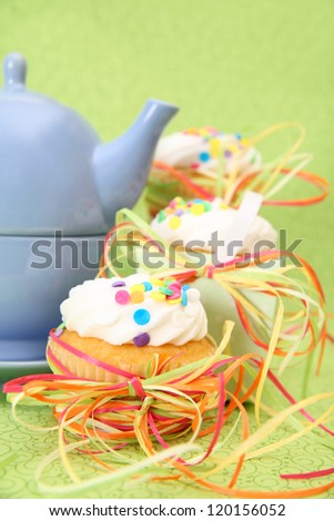 Tea Party with three cupcakes and a blue teapot - stock photo