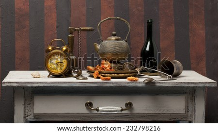 tea pot and cups on wooden table - stock photo