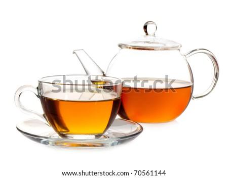 tea pot with tea and cup - stock photo