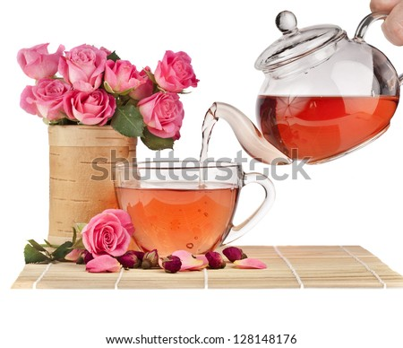 tea rose  on bamboo tablecloth isolated on white - stock photo