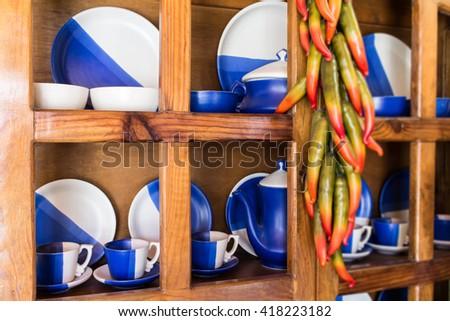 Tea set in a wooden cupboard.Tea set in a wooden cupboard.  - stock photo