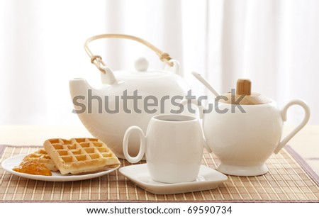 Tea set including a teacup, a teapot and a sugar bowl
