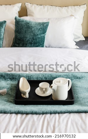 tea set on black tray in modern bedroom at home